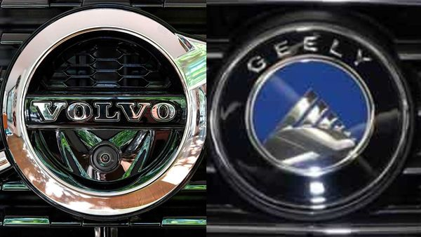Logos of Volvo (L) and Geely (R)