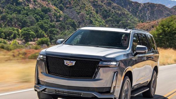 This photo provided by General Motors shows the 2021 Cadillac Escalade, a three-row luxury SUV with a standard V8 engine and enormous digital display screens. (Courtesy of General Motors via AP) (AP)