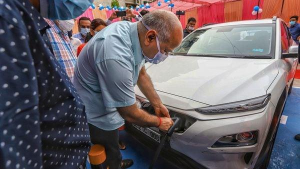 Delhi's Deputy Chief Minister Manish Sisodia during the inauguration of an electric vehicle charging station, at 11KV substation, Patparganj. (File photo) (PTI)