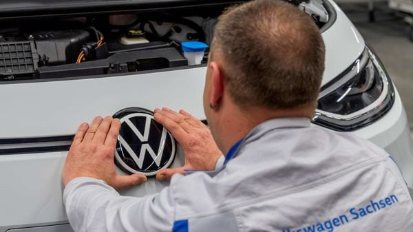 FILE PHOTO: An employee fixes a VW sign at a production line of the electric Volkswagen model ID.3 in Zwickau, Germany, February 25, 2020. REUTERS/Matthias Rietschel/File Photo (REUTERS)