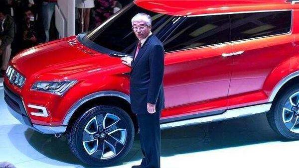 Managing-director-and-CEO-Maruti-Suzuki-India-S-Nakanishi-poses-with-the-new-XA-Alpha-concept-SUV-car-during-the-2012-Auto-Expo-in-New-Delhi-AFP-Manan-Vatsyayana