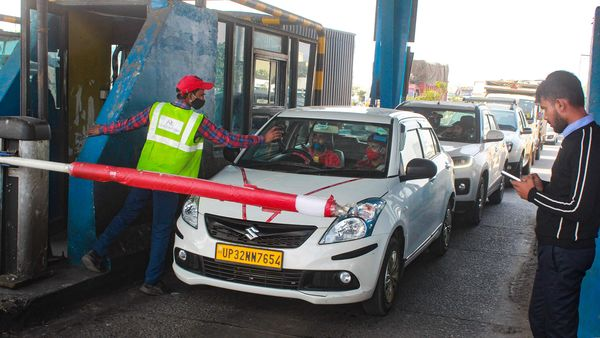 Vehicles at the Kherki-Daula toll plaza on the first day of the implementation of the FASTag toll system, in Gurugram. (File photo) (PTI)