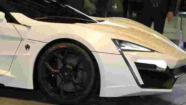 A-man-walks-past-the-first-Arabian-supercar-LykanHypersport-during-the-third-International-Qatar-Auto-Show-on-January-28-2013-in-Doha-Created-by-Beirut-based-W-Motors-the-LykanHypersport-is-labeled-as-the-most-exclusive-luxurious-and-technologically-advanced-Hypercar-in-the-world-that-boasts-never-seen-before-cutting-edge-technologies-inside-and-out-Photo-AFP-Al-Watan-Doha-Karim-Jaafar