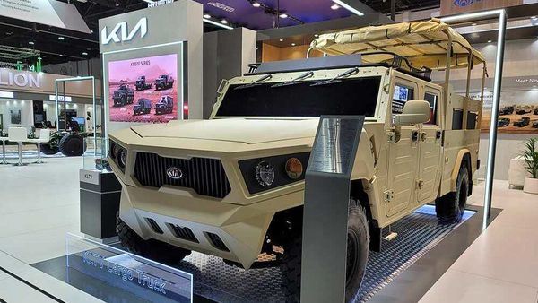 Kia concept military vehicle on display at a defense expo in UAE.