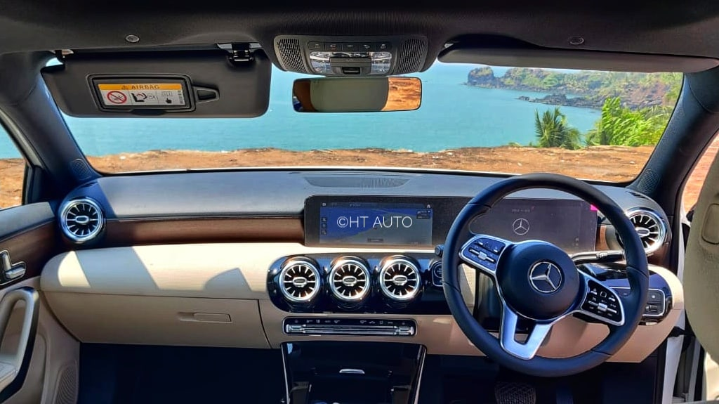 A-Class packs in a 10.25-inch infotainment screen which merges with another 10.25-inch driver display unit. Turbine-like air vents, ambient lights, latest MBUX system, walnut open pore trim and more highlight the cabin of the sedan. (Image: HT Auto/Sabyasachi Dasgupta)