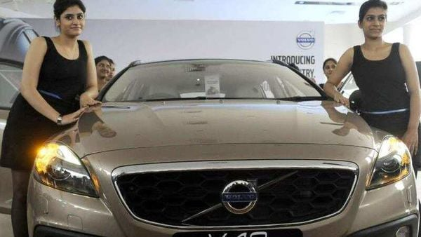 Models-with-new-volvo-car-V40-Cross-Country-at-their-showroom-Swede-Showroom-sector-53-in-Gurgaon-India-on-Friday-June-14-2013-This-car-ex-showroom-price-is-28-5-lacs-Photo-HT-Parveen-Kumar