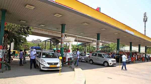 Vehicle line up for CNG filling in New Delhi.
