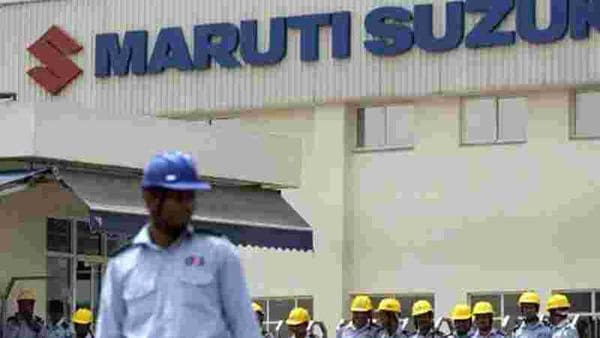 Private-security-guards-stand-in-front-of-the-main-gate-of-the-Maruti-Suzuki-Production-Facility-in-Manesar-AFP
