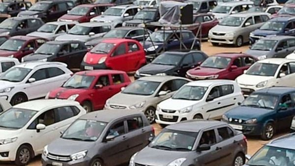 Bengaluru: Members of a Church, adhering to social distancing norms, sing and pray while sitting in their cars after parking them on ground during drive-in worship, amid the ongoing COVID-19 lockdown, in Bengaluru, Sunday, June 14, 2020. (PTI Photo/Shailendra Bhojak)(PTI14-06-2020_000068B) (PTI)