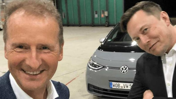 Herbert Diess, chief executive of VW Group (left) along with Elon Musk, Tesla CEO (right)