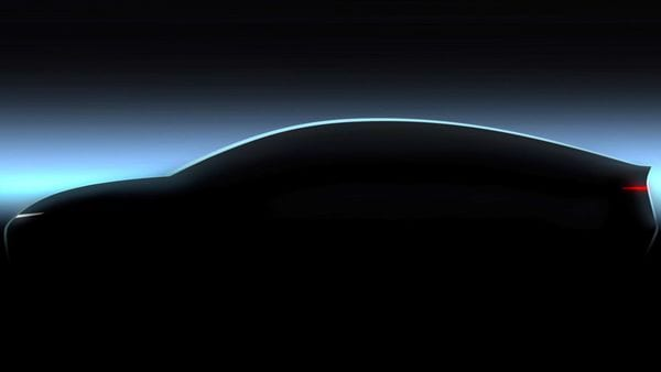 Volkswagen has teased a silhouetted glimpse at its upcoming electric sedan Project Trinity.