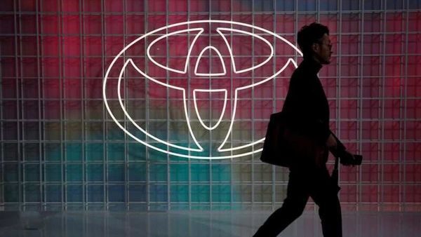 File photo: A man walks past a Toyota logo at the Tokyo Motor Show, (REUTERS)