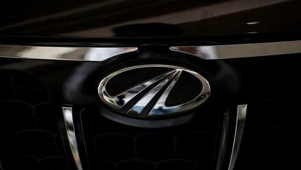 The logo of Mahindra and Mahindra is seen on a car at a showroom. (File photo) (REUTERS)