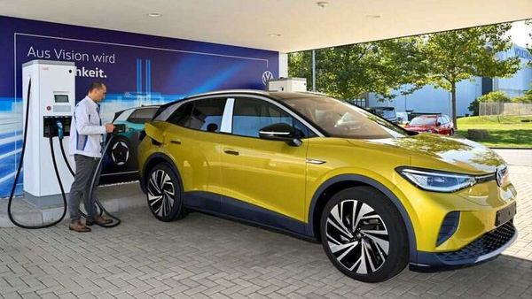 An employee presents the new electric Volkswagen model ID. 4 during a media show in Zwickau, Germany. (File Photo) (REUTERS)