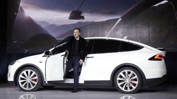 Elon Musk with a Tesla EV