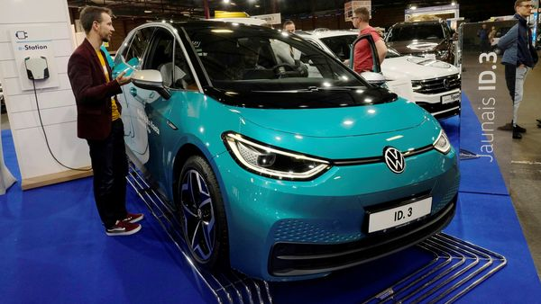 People gather next to the Volkswagen ID.3 electric car during the International Motor Show. (File Photo) (REUTERS)