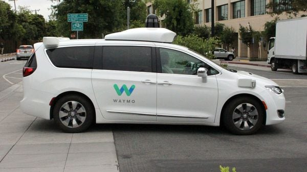 A Waymo self-driving car pulls into a parking lot at the Google-owned company's headquarters in Mountain View, California. (AFP)