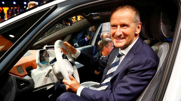 Herbert Diess, CEO of German carmaker Volkswagen AG, poses in an ID.3 pre-production prototype during the presentation of Volkswagen's new electric car. (File Photo) (REUTERS)