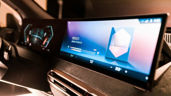 BMW showcased the next-generation iDrive operating system and infotainment screen that will debut on the upcoming BMW iX electric vehicle.