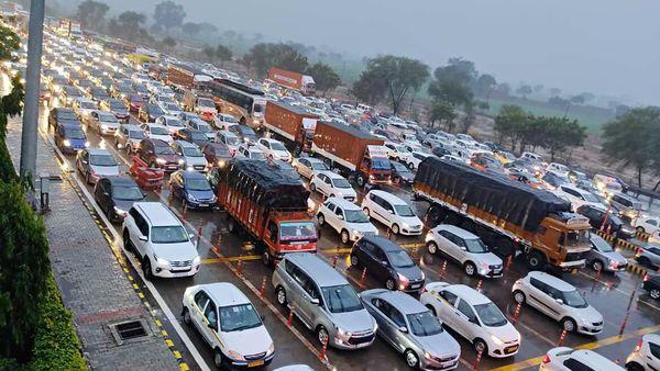 File photo of vehicles stuck in many kilometres jam on Yamuna Expressway. (ANI)