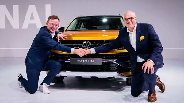 File photo of Steffen Knapp (L) with Jürgen Stackmann, Member of the board for Volkswagen brand responsible for sales, with the Taigun SUV.