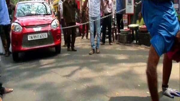 Chatrapathy pulling the car by walking upside down. (Image: ANI)