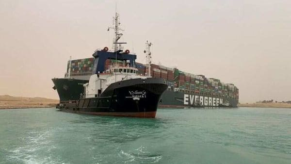A container ship which was hit by strong wind and ran aground is pictured in Suez Canal, Egypt. (VIA REUTERS)