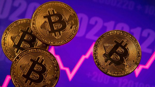 File photo - A representation of virtual currency Bitcoin is seen in front of a stock graph. (REUTERS)