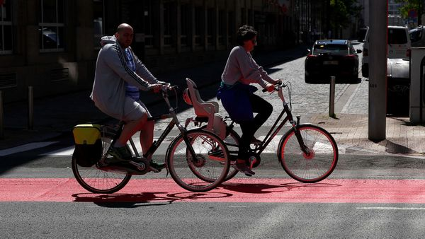 FILE PHOTO: People ride bicycles on a new cycling lane in central Brussel, amid the coronavirus disease outbreak in Brussels, Belgium. (REUTERS)