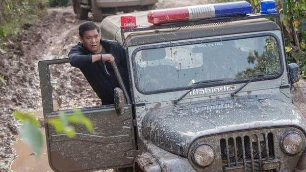 Arunachal CM Pema Khandu seen tackling muddy section of a road on a Mahindra Thar SUV.