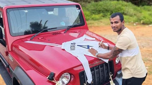 India cricketer T Natarajan with the Thar gifted to him for his efforts with the ball against Australia.
