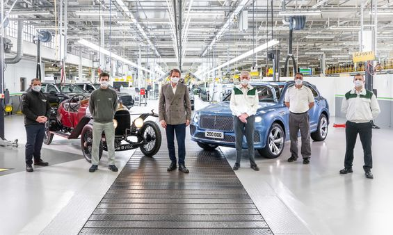 The oldest Bentley in existence, EXP 2 (L), stands proudly alongside the 200,000th car, with Bentley's longest serving colleagues witnessing the moment.