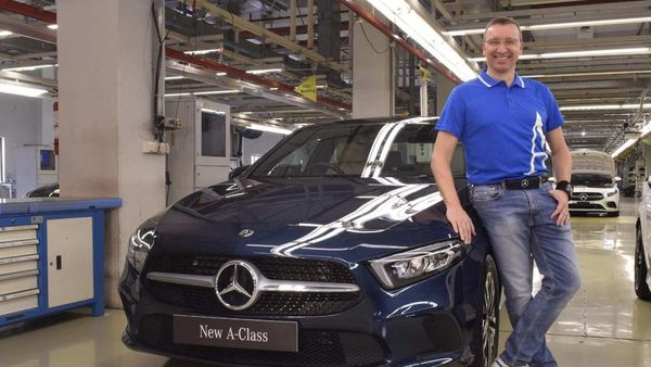 Martin Schwenk, MD and CEO at Mercedes-Benz India, is seen with the new A-Class Limousine.
