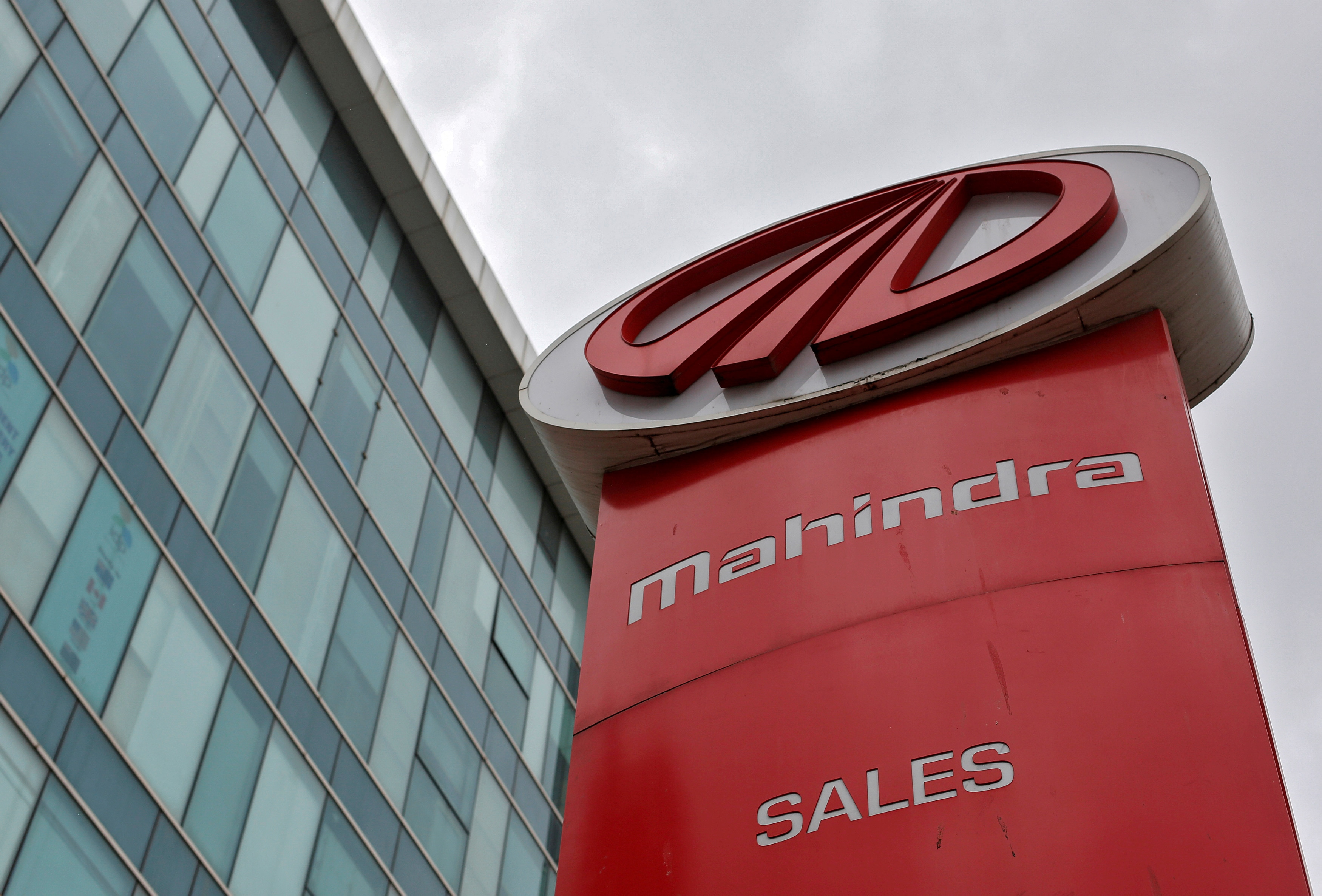 FILE PHOTO: A Mahindra and Mahindra sign at one of the carmaker's showrooms in Mumbai, India, August 30, 2016. REUTERS/Danish Siddiqui/File Photo (REUTERS)