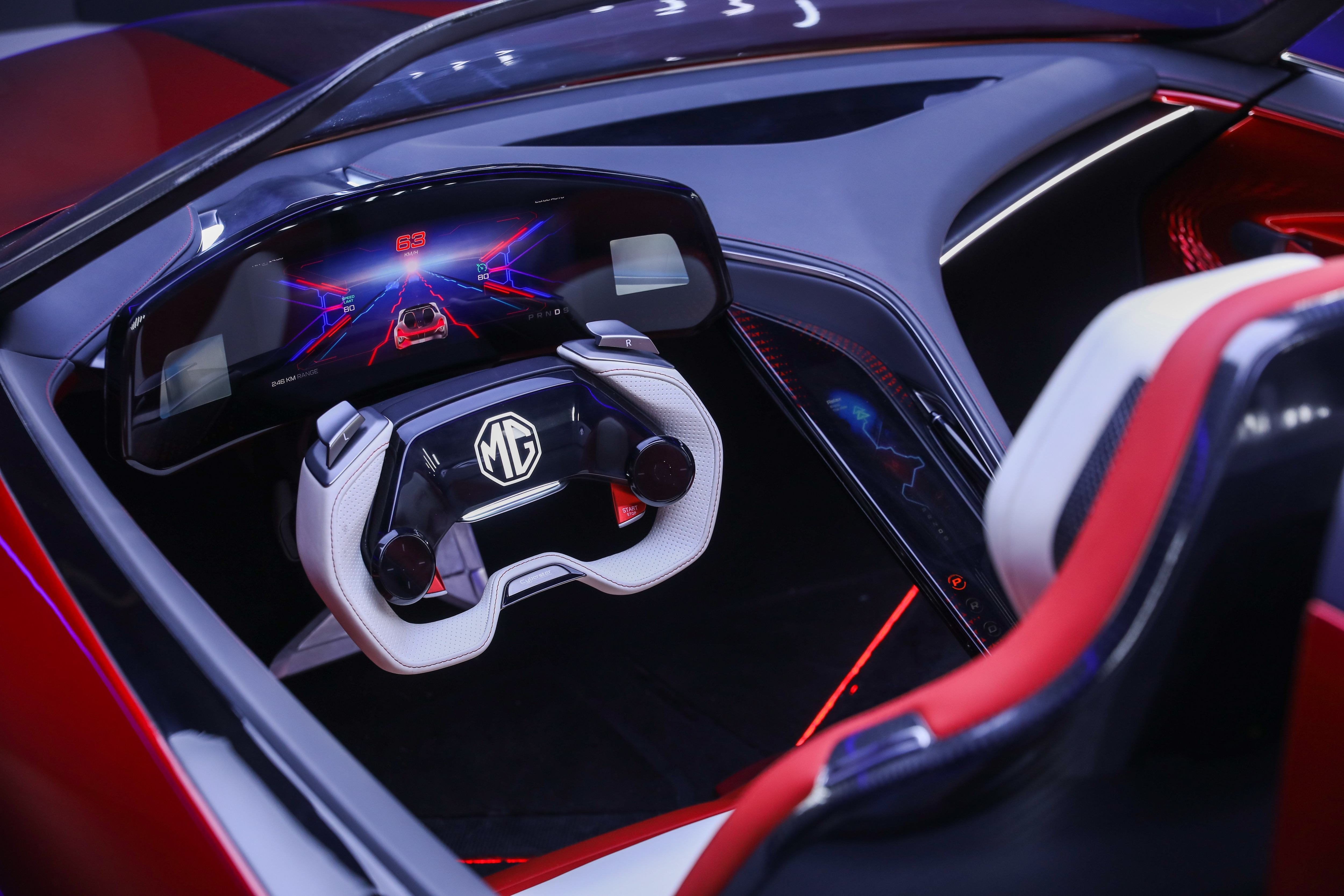 The cockpit of the MG Cyberster appears like a gaming console with the steering wheel and the all-digital instrument cluster.