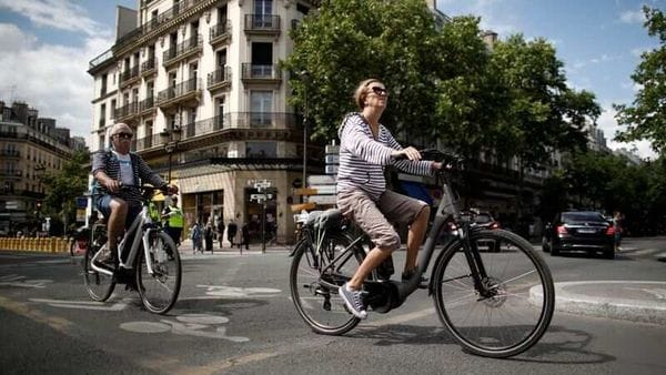 A woman rides an electric bike in Paris, France. (File Photo) (REUTERS)