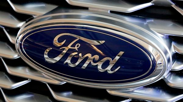 File photo of Ford logo. Ford's Kentucky Truck Plant and Louisville Assembly Plant are using about 2,000 temporary workers. (AP)