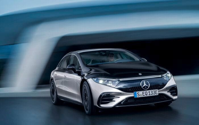 The EQS is the first product to be fully based on Mercedes' all electric platform. It has a smoothly-flowing front grille with the prominent Mercedes tri-star logo.
