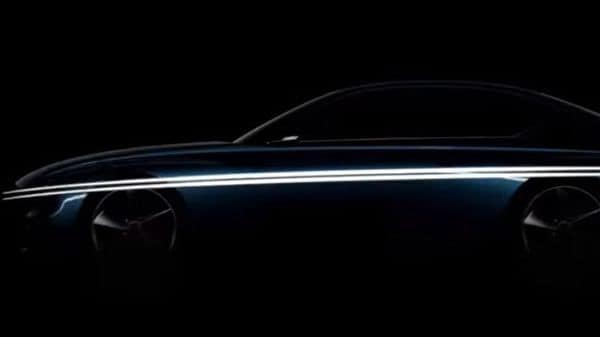 The teaser video shows the Genesis electric car's front grille and headlamps inspired by the automaker's new