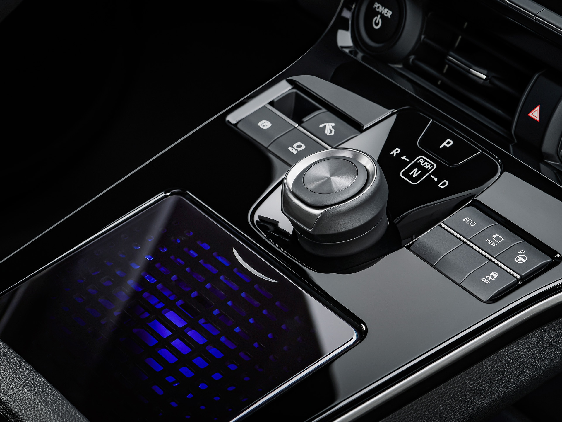 Instead of conventional dials and knobs and buttons, the Toyota bZ4X gets a large touchpad that can act as the controller of several functions of the car. Besides that it also gets a large central dial and couple of buttons.