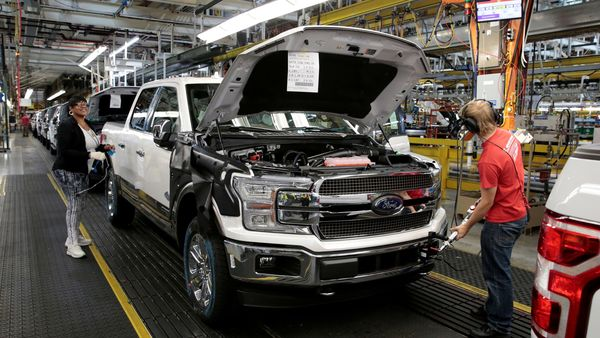 Ford employees seen working on a F150 pick-up truck at the assembly line at Ford's Dearborn Truck Plant in Michigan. (File Photo) (REUTERS)