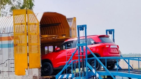 File photo of a Maruti Suzuki Vitara Brezza being loaded on a train for transportation.