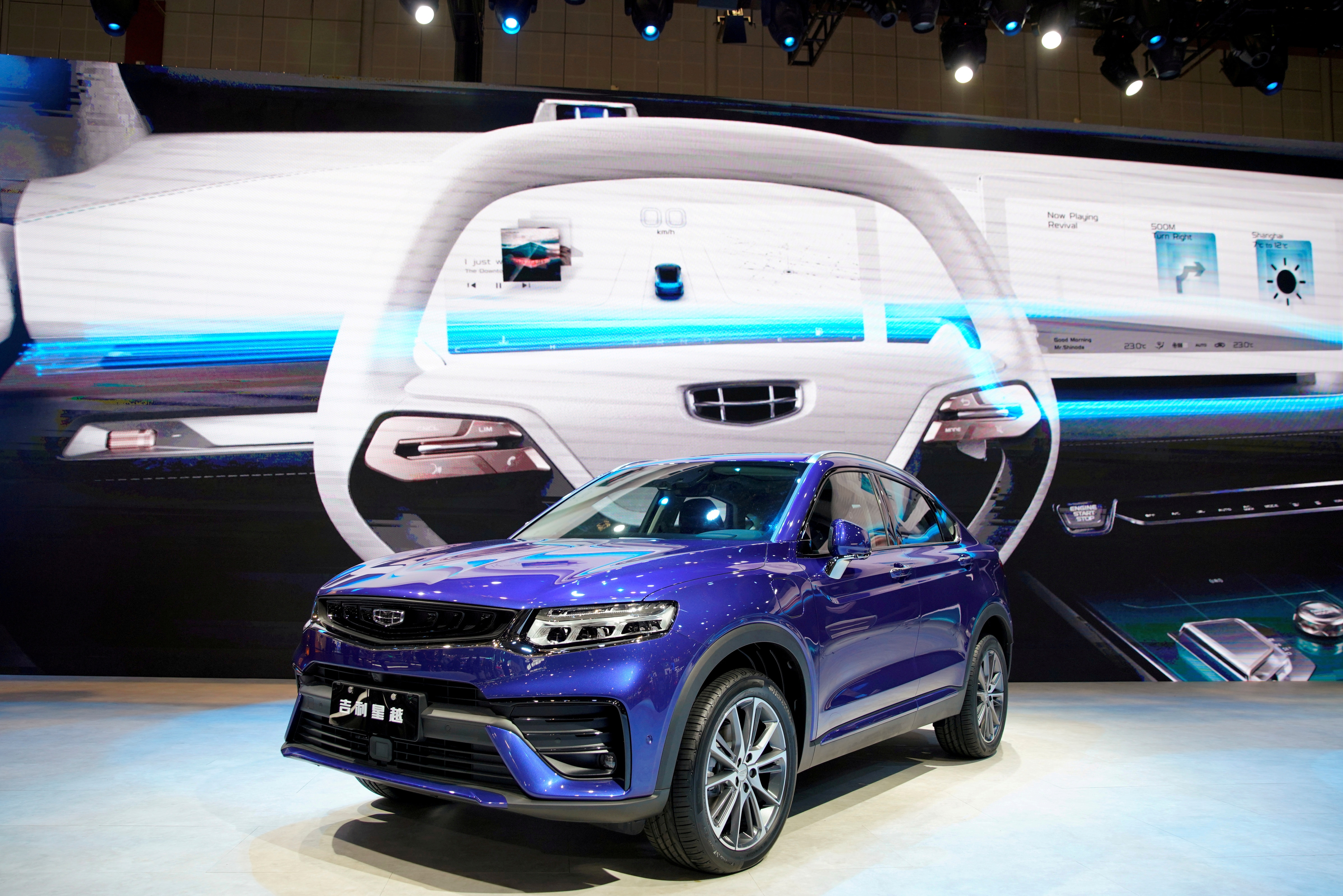 A Geely Xingyue Coupe SUV is seen displayed at the auto show. (REUTERS)