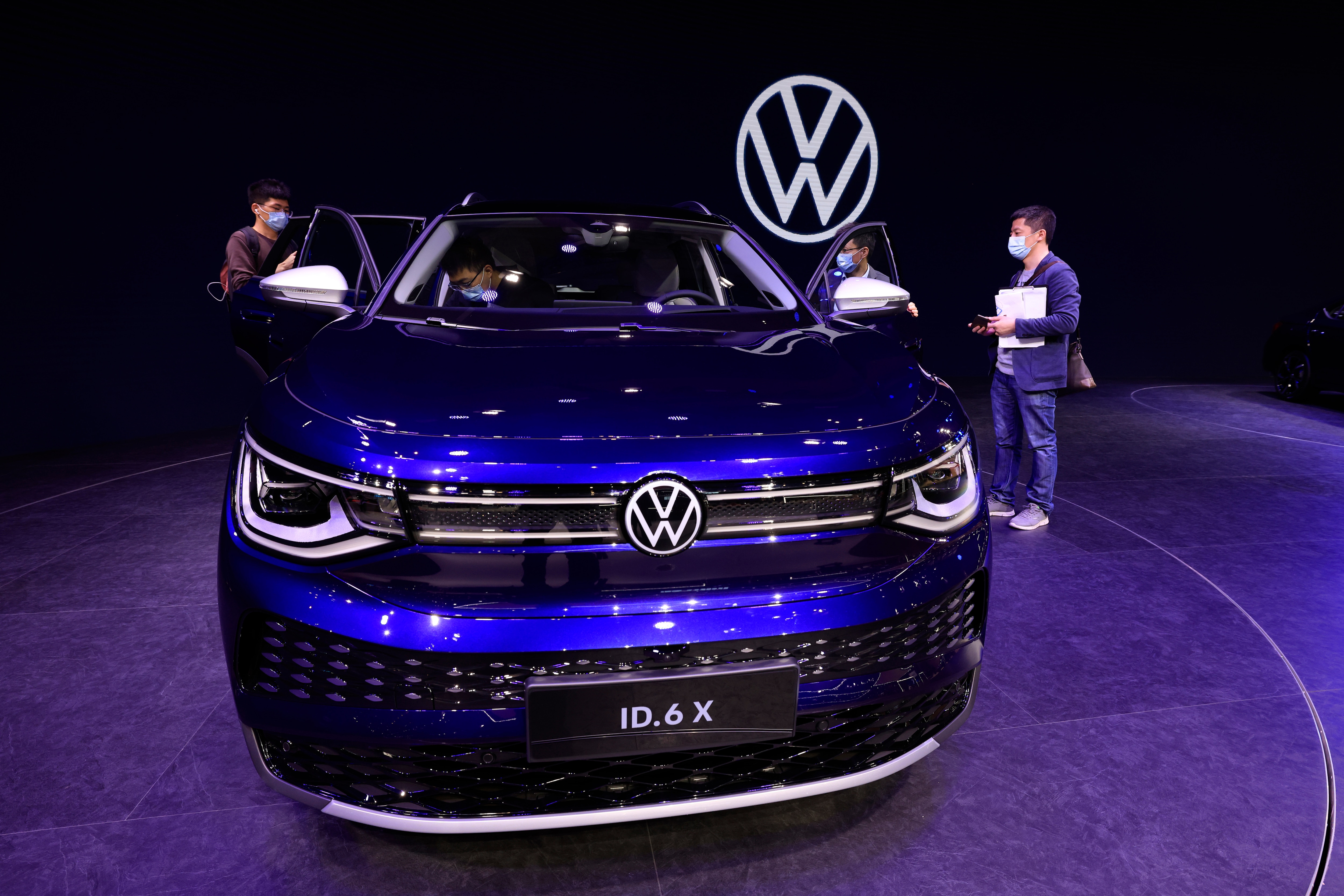 The latest electric car from Volkswagen, the ID.6 X, has been put on display at the Shanghai Auto Show 2021. A visitor can be seen sitting inside the car to check it out. (AP)