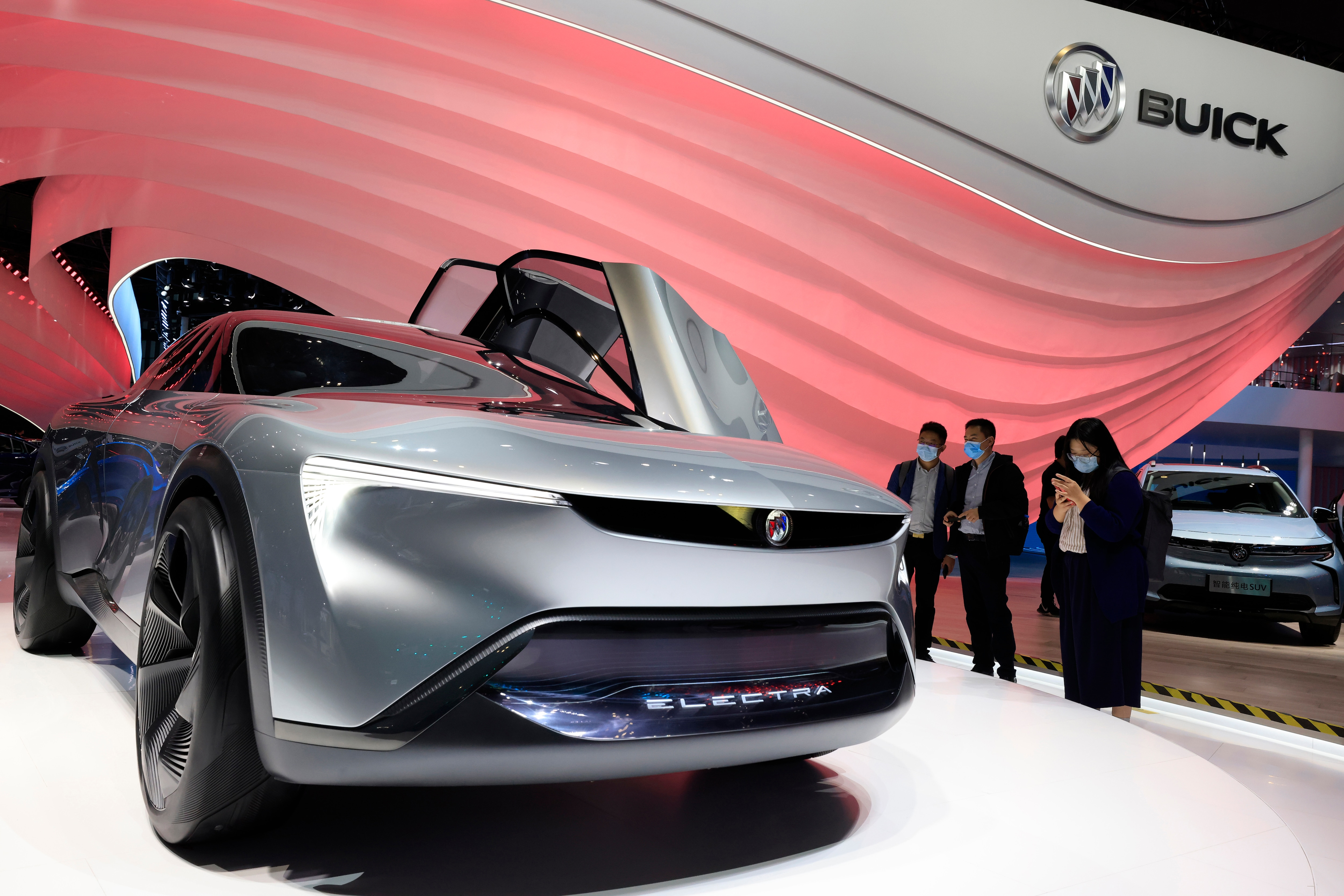 The Electra concept car from Buick has been put on display. Visitors look at the concept vehicle at the Buick booth. (AP)