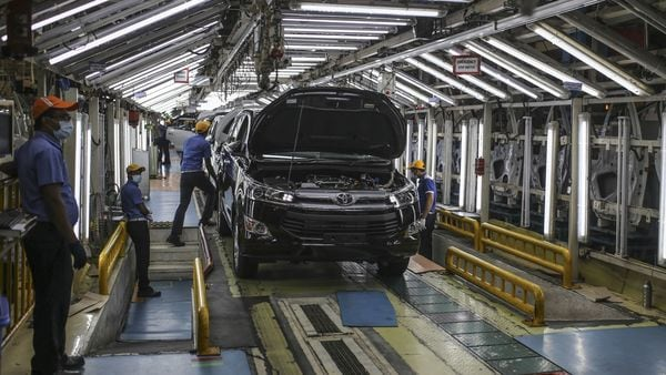 File photo: Workers make checks at a trim inspection line on the Innova Crysta multi-purpose vehicle (MPV) production line at the Toyota Kirloskar Motor plant in Bidadi, Karnataka. (Bloomberg)