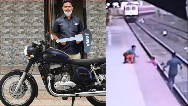 Railways Pointsman Mayur Shelke poses next to his Jawa forty two Golden Stripes Nebula Blue motorcycle he received as token of appreciation for his heroics (right)