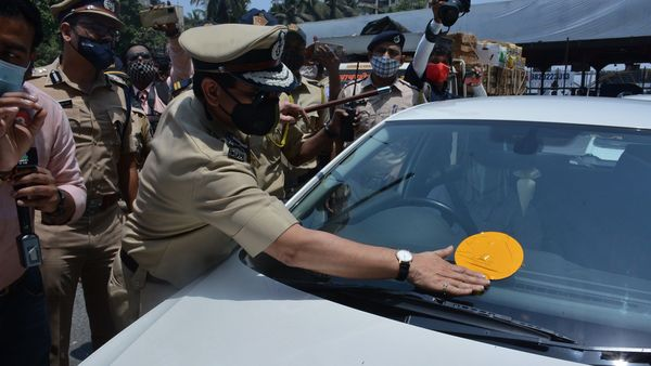 Mumbai Police Commissioner Hemant Nagarale putting up stickers on vehicles carrying citizens who work in the Emergency Services. (File photo)