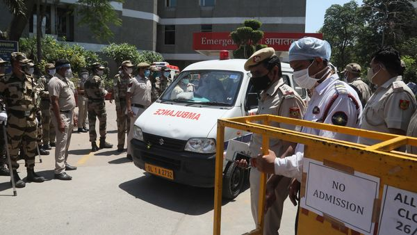 File Photo: Police personnel look on as ambulances carrying Covid-19 victims exit Jaipur Golden hospital, in New Delhi, on Saturday, April 24, 2021.