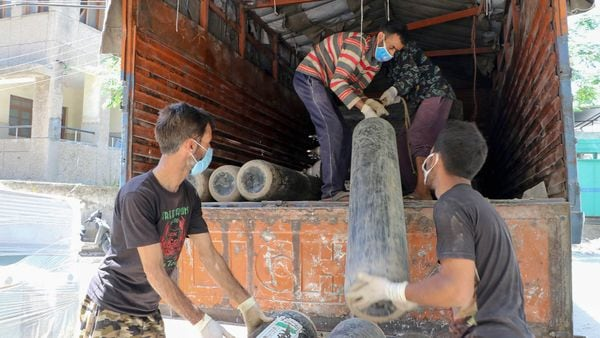 Jammu: Workers carry medical oxygen cylinders for Covid-19 patients, in Jammu, Sunday, April 25, 2021. (PTI)